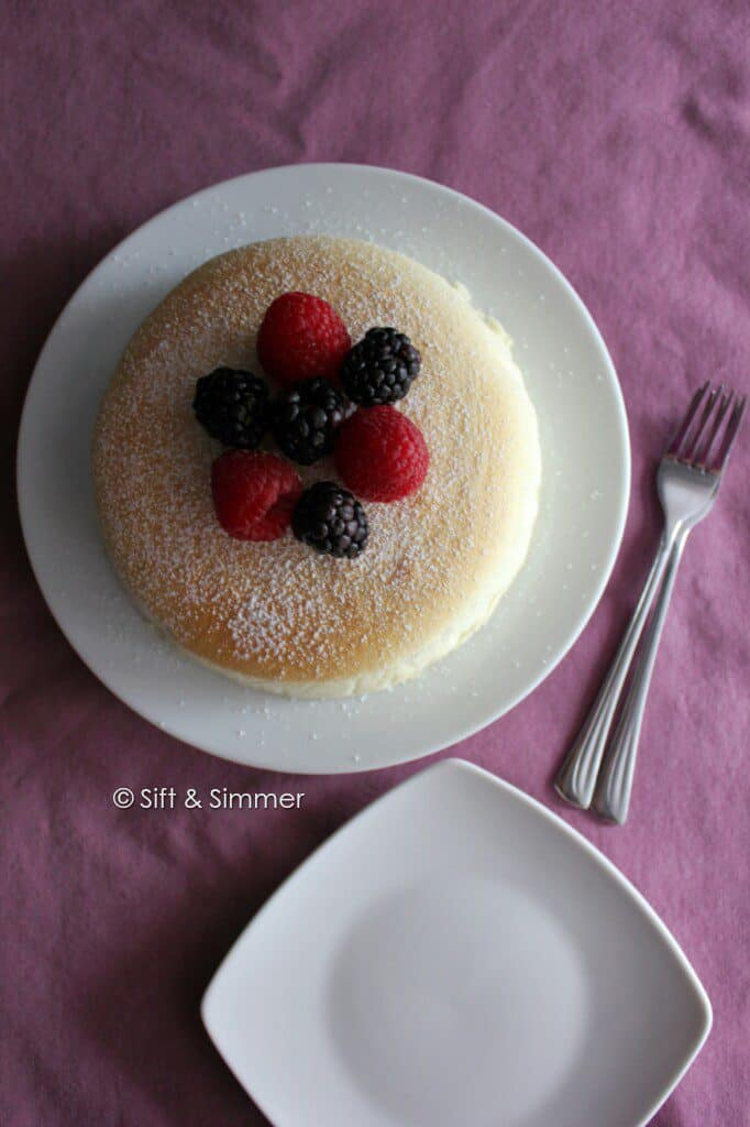 Japanese Cotton Cheesecake on white round plate with forks.