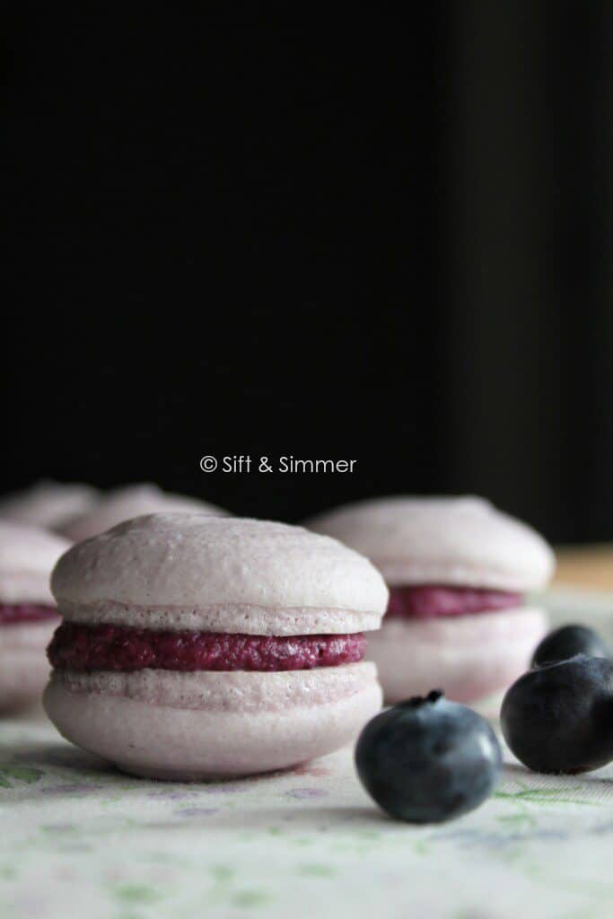 Vegan Blueberry Macarons with blueberries.