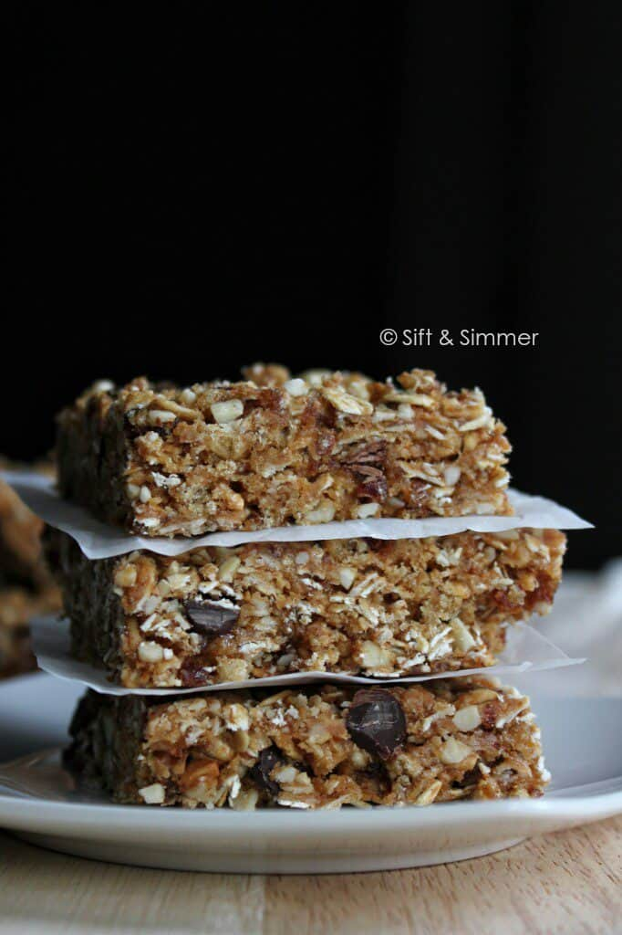 Stack of Chocolate Peanut Butter Crunch Clif Bars on white plate.