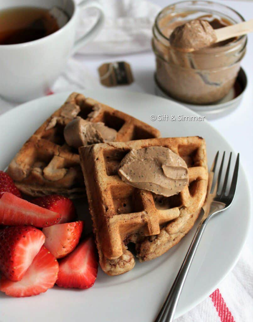 Earl Grey Milk Jam Spread on Chickpea Peanut Butter Waffles on white round plate with fork.