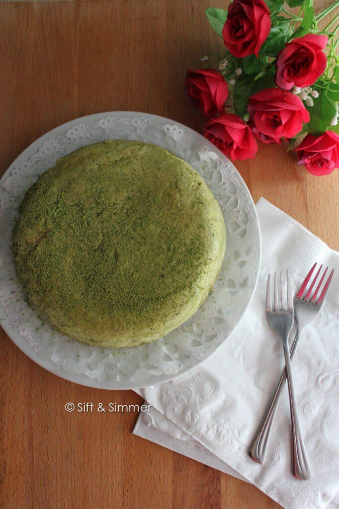Matcha Cotton Cheesecake on plate with forks on side.