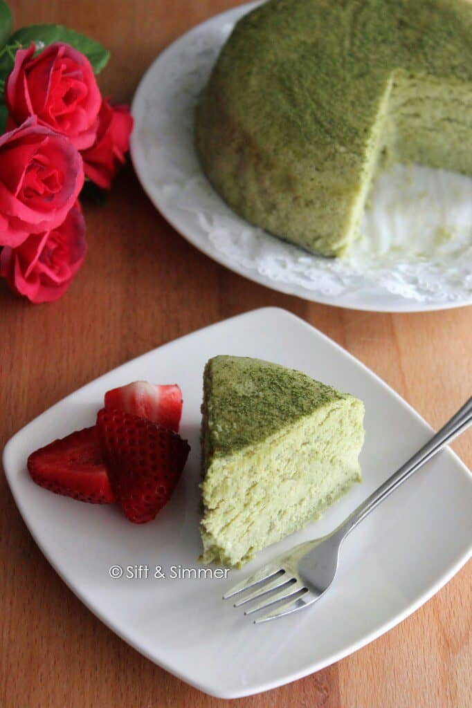 Slice of Matcha Cotton Cheesecake on plate with fork.