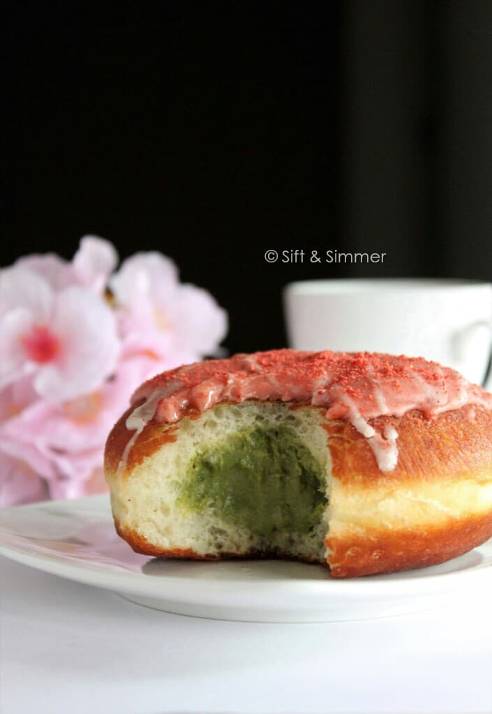 Bitten Strawberry Doughnut with matcha filling.