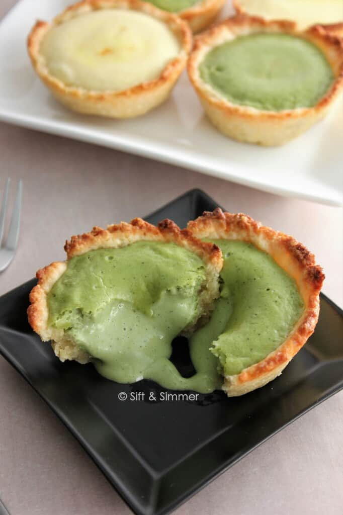 Molten Matcha Lava Cheese Tart on square black plate.