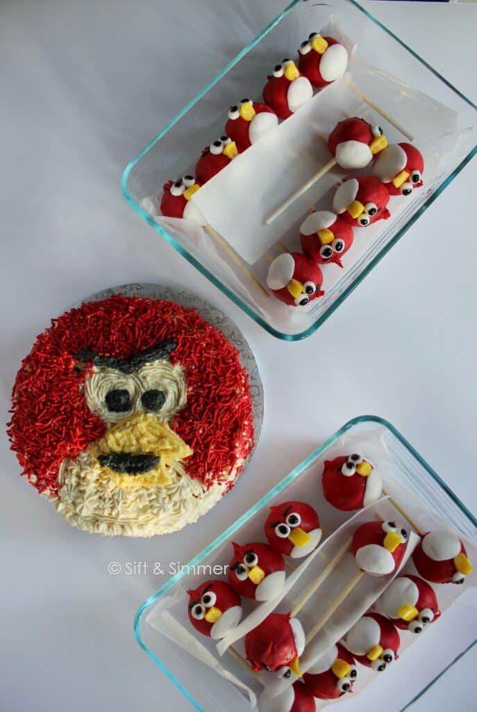 Angry Bird Cake with Angry Bird Cake Pops in containers.