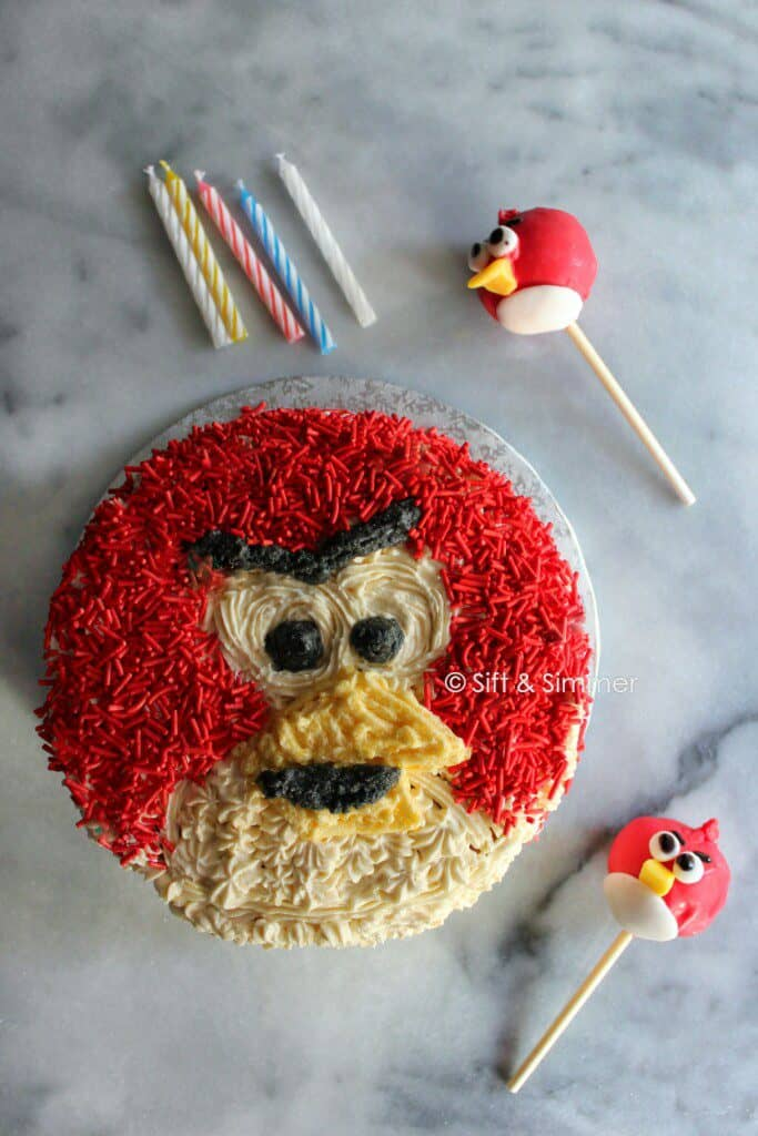 Angry Bird Cake with Angry Bird Cake Pops, candles.
