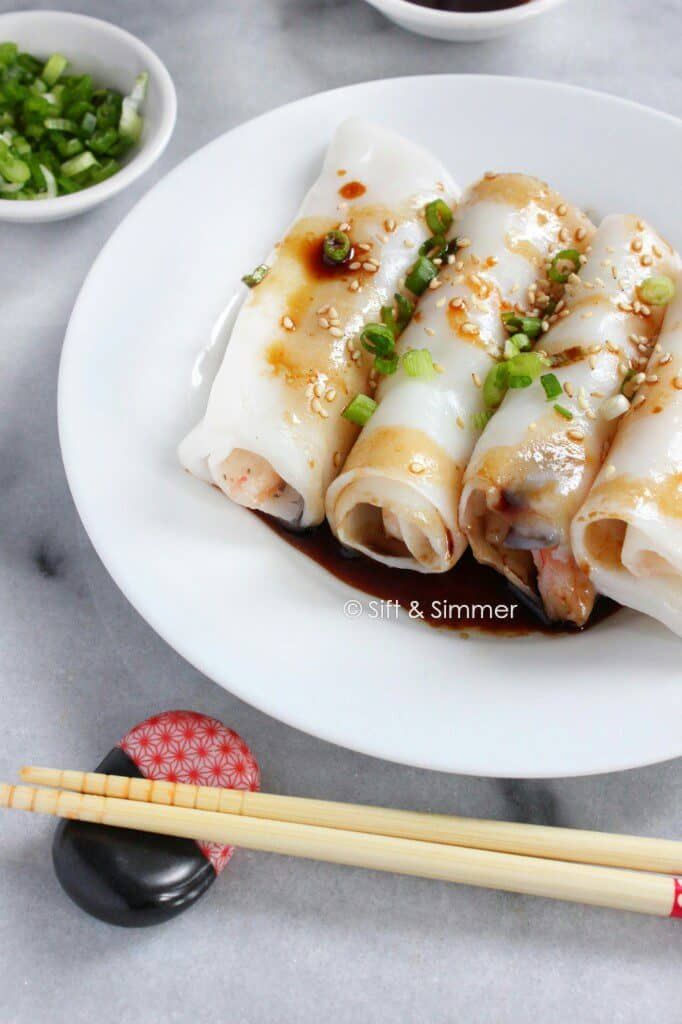 Chee Cheong Fun Rice Noodle Rolls on white plate, with chopsticks on side.