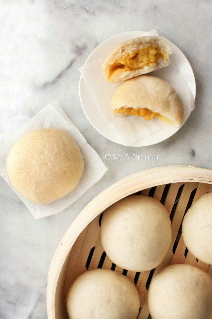 Custard Buns Lai Wong Bao in bamboo steamer and white plate.