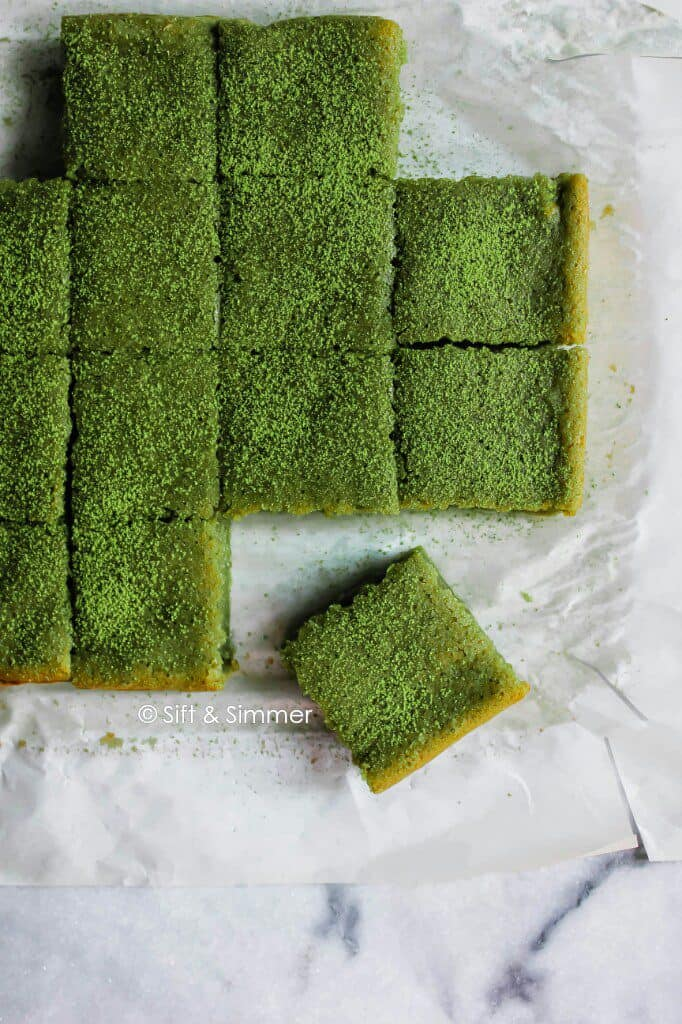 Matcha Brownie Mochi Brochi on parchment.