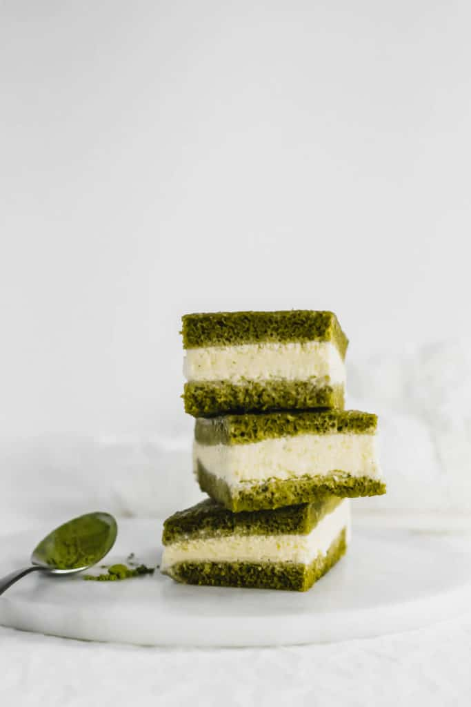 Stack of 3 Matcha Ice Cream Sandwiches on marble trivet.