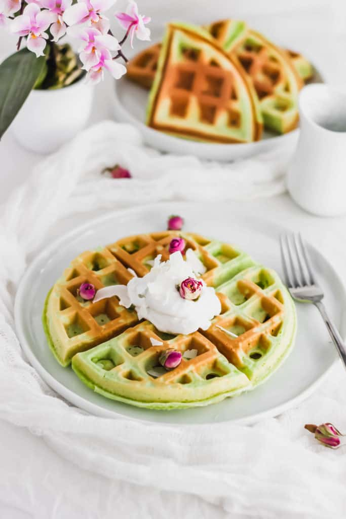 Pandan Mochi Waffles on white round plate with fork.