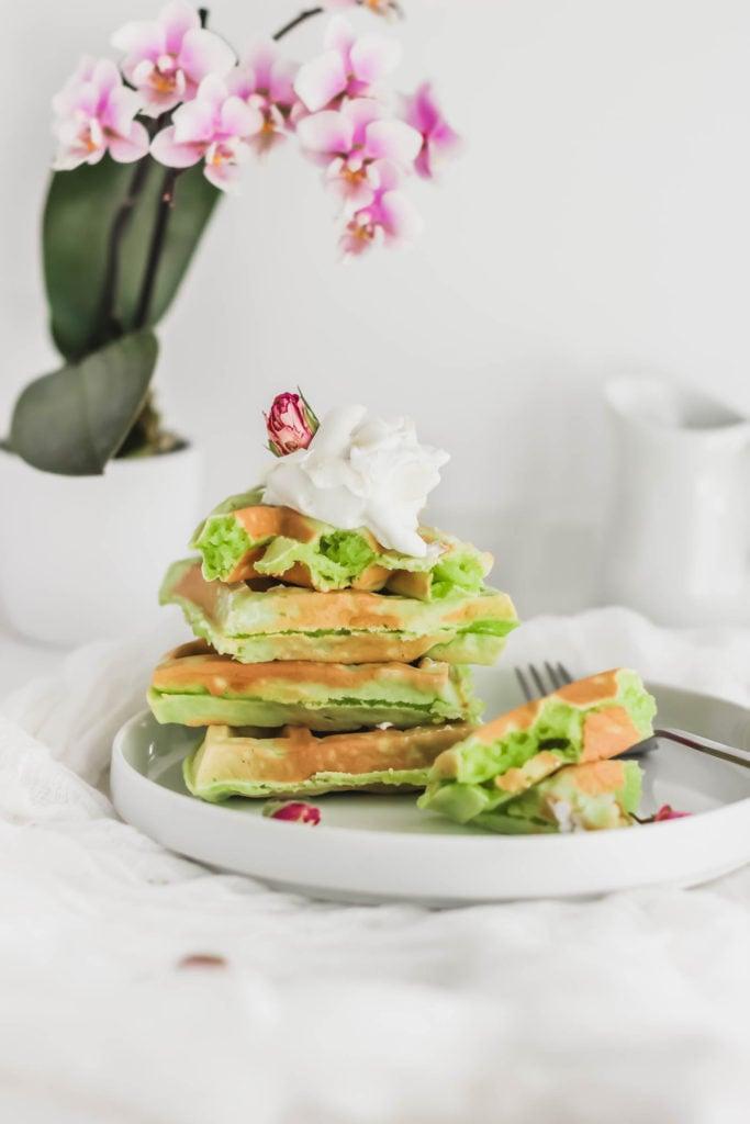 Stack of Pandan Mochi Waffles on white round plate.