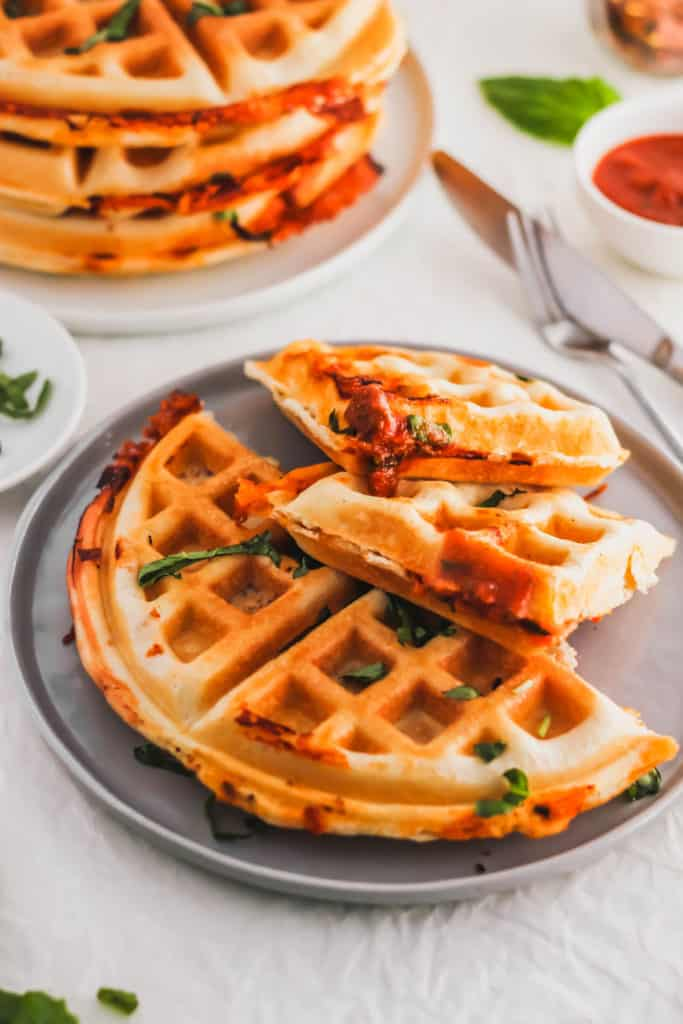 Pizza Waffles on grey plate.