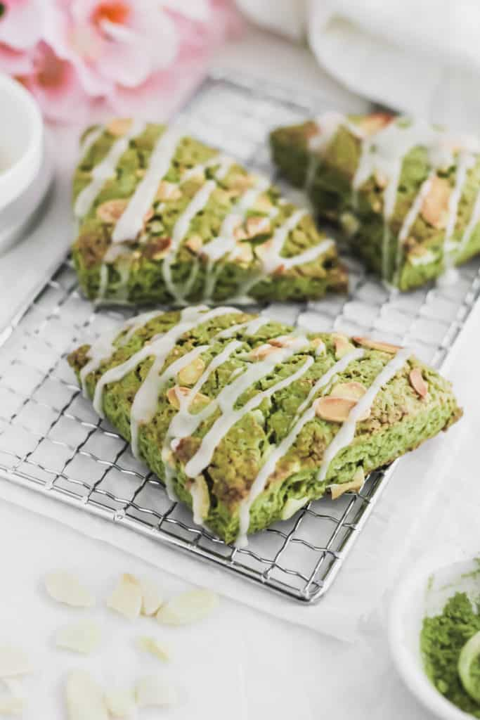 Close up of Matcha Almond Scones on cooling rack.