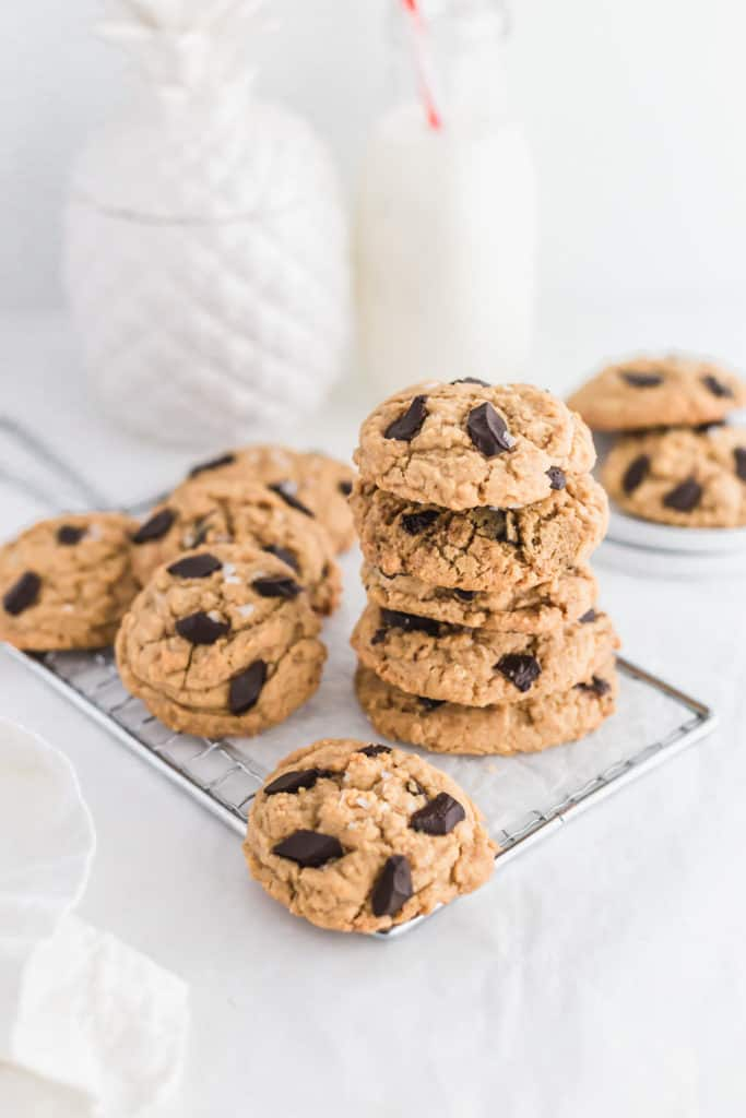 Stack of SunButter Chocolate chunk cookies on cookie rack.