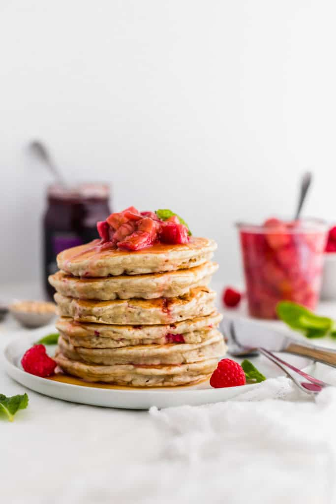 Stack of pancakes with rhubarb compote on top.