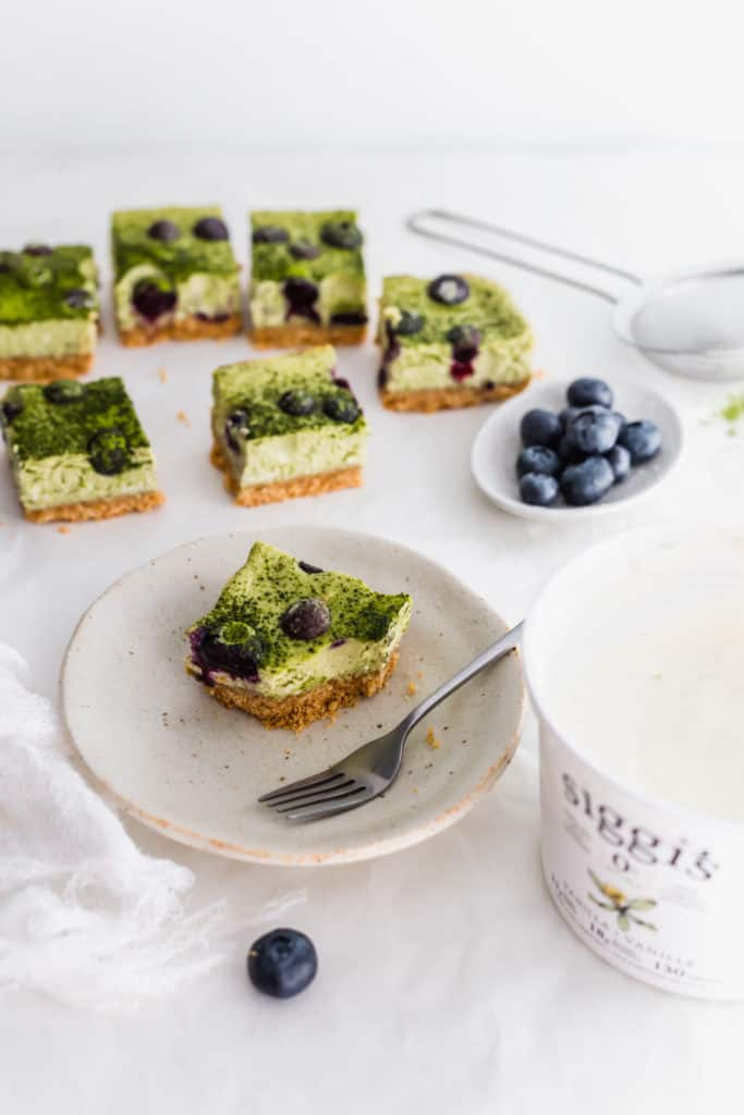 Matcha blueberry cheesecake bar with blueberries, siggi's yogurt container on side.