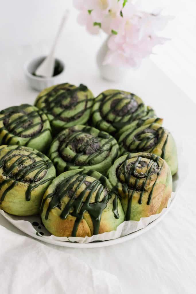 Matcha black sesame rolls on a large plate.