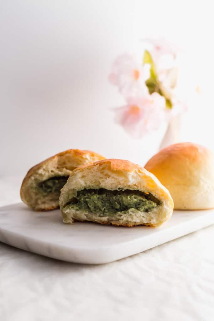 Ripped bun with matcha custard exposed.