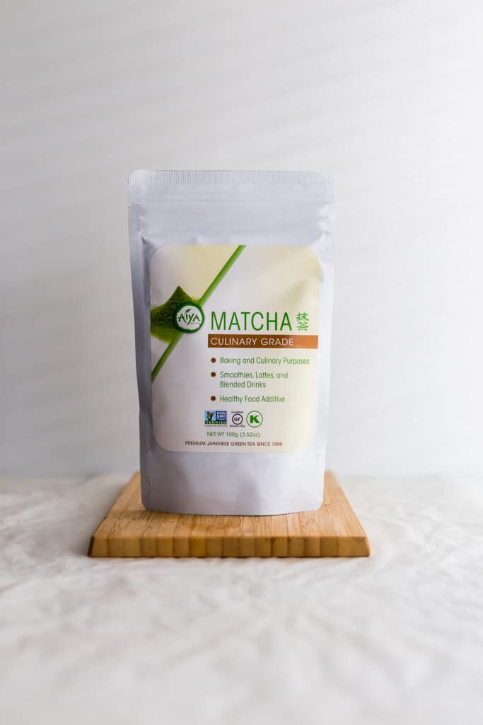 A package of matcha powder on wooden board.