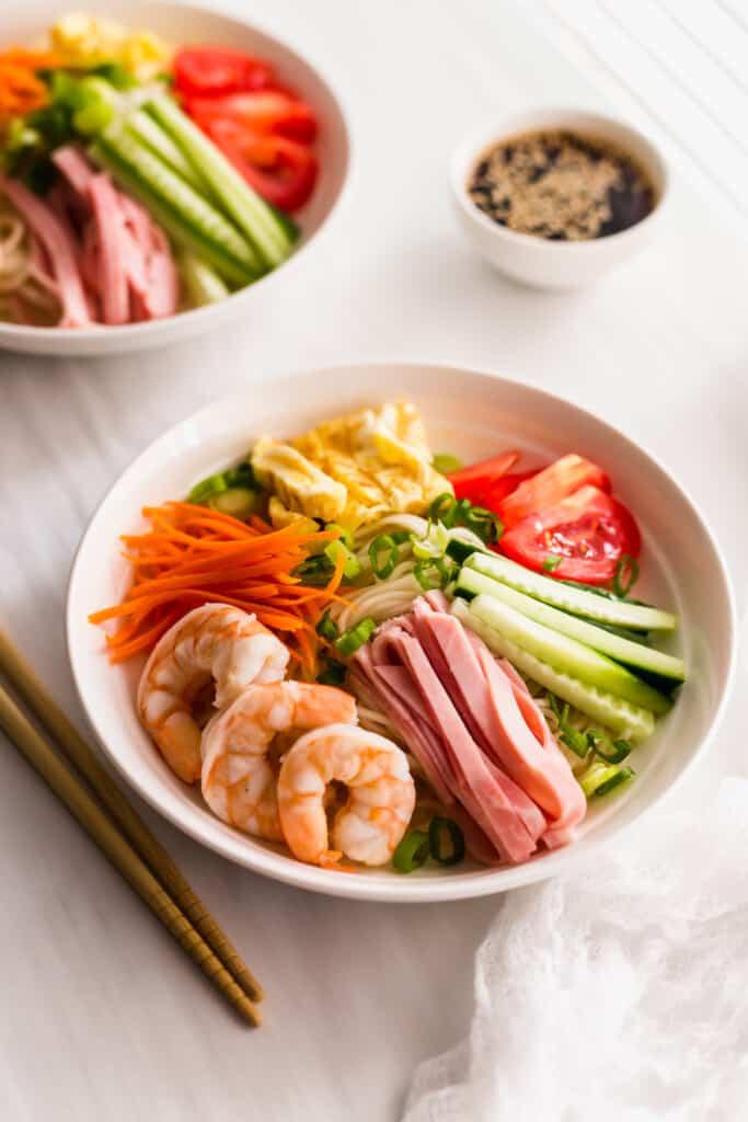 Hiyashi Chuka Cold Ramen Noodles in white bowl with chopsticks on side.