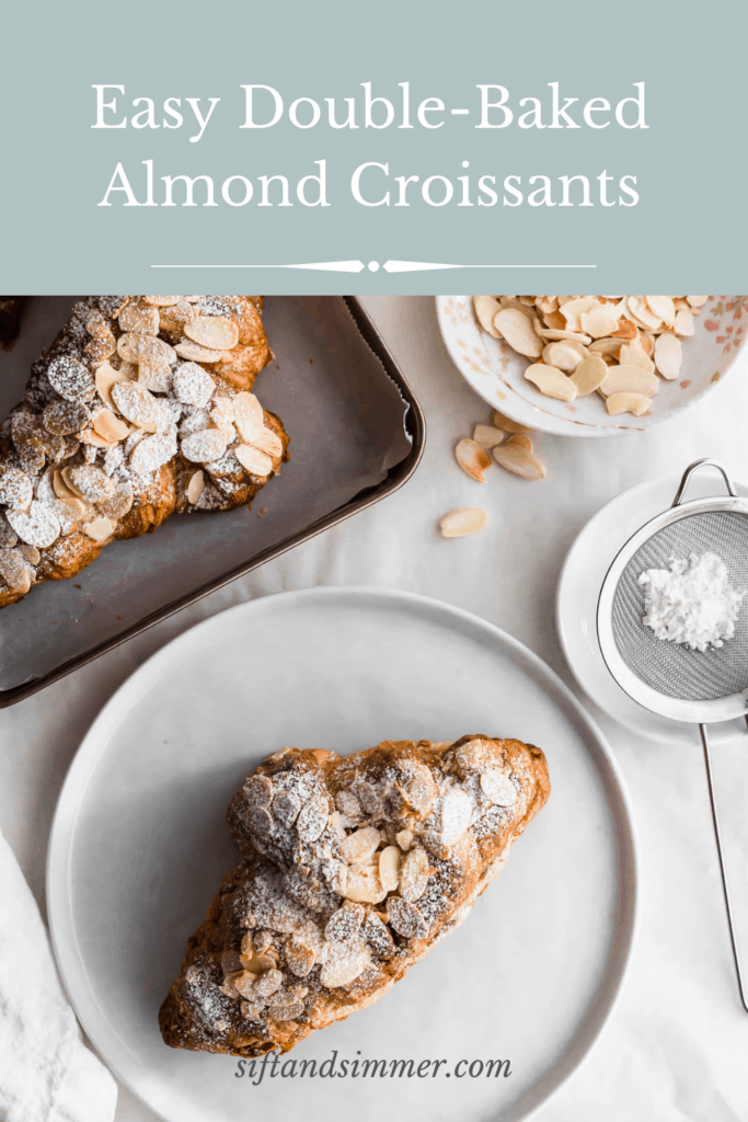 Almond croissant on a white round plate with tray of almond croissants on a tray, flaked almonds scattered around with text overlay.