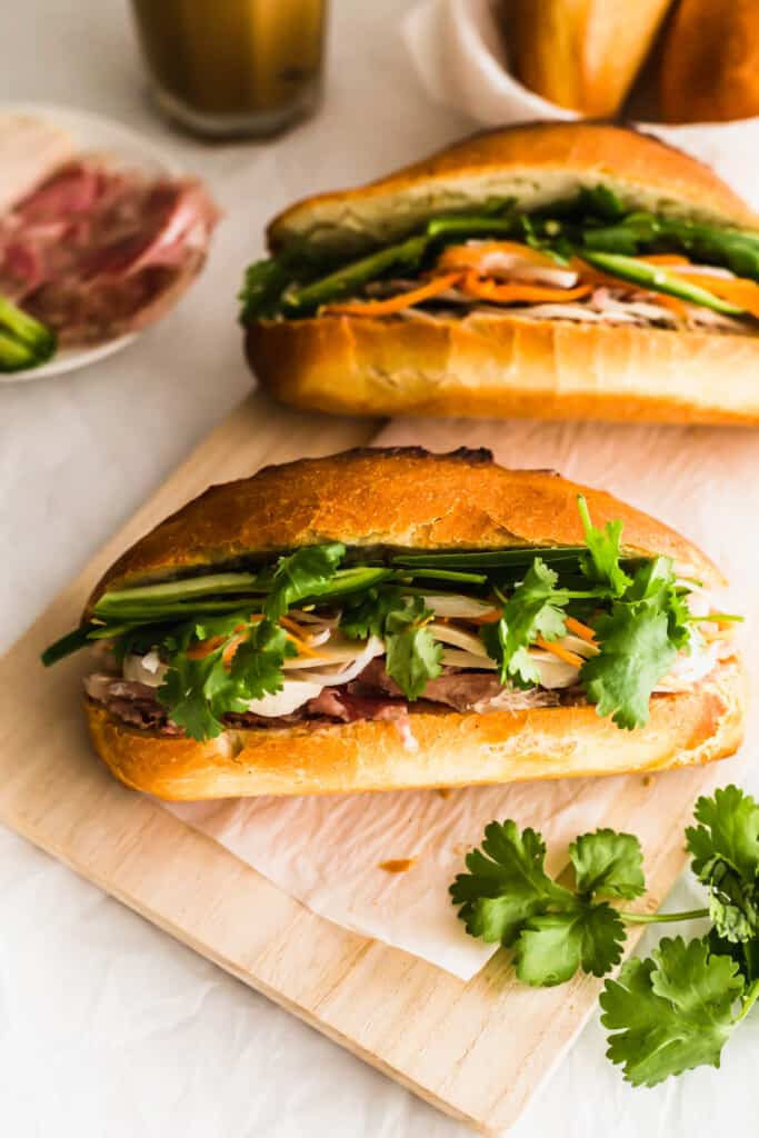 Banh mi sandwiches on wooden board.