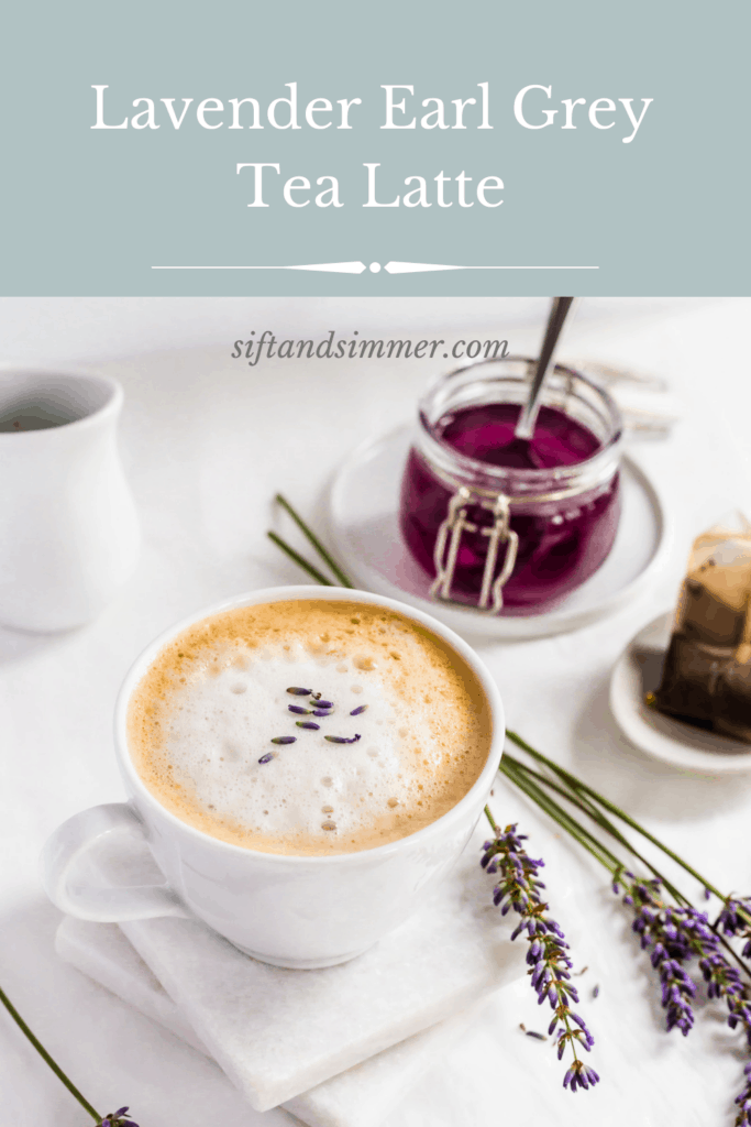 Mug of lavender earl grey tea latte on white marble coasters with lavender flowers, with text overlay.