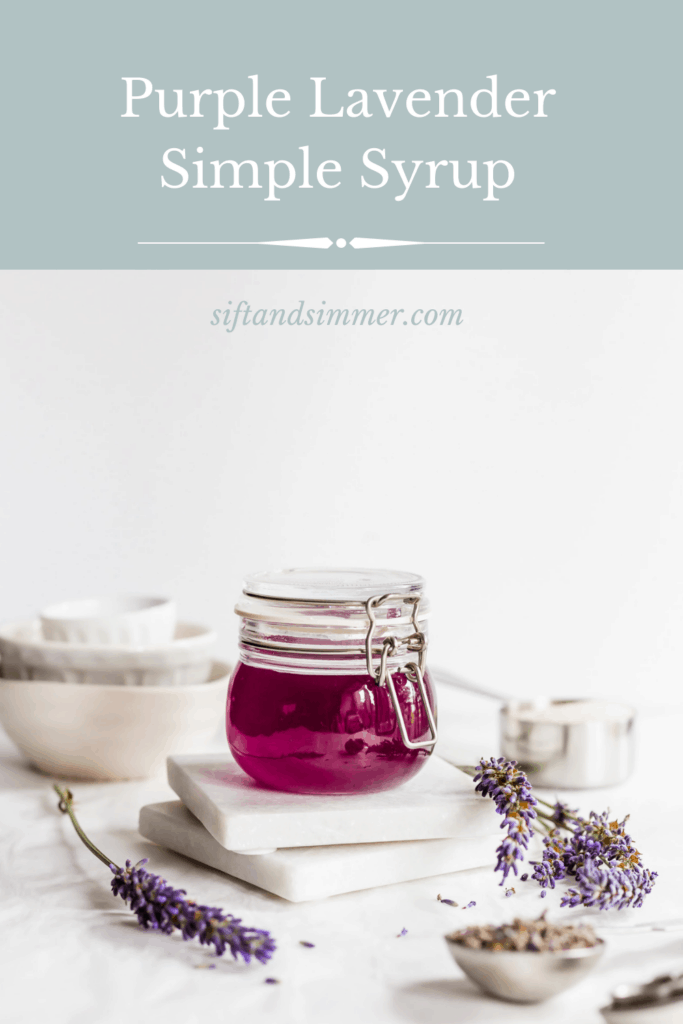 Jar of purple lavender syrup on marble coasters with sprigs of lavender flowers, with text overlay.