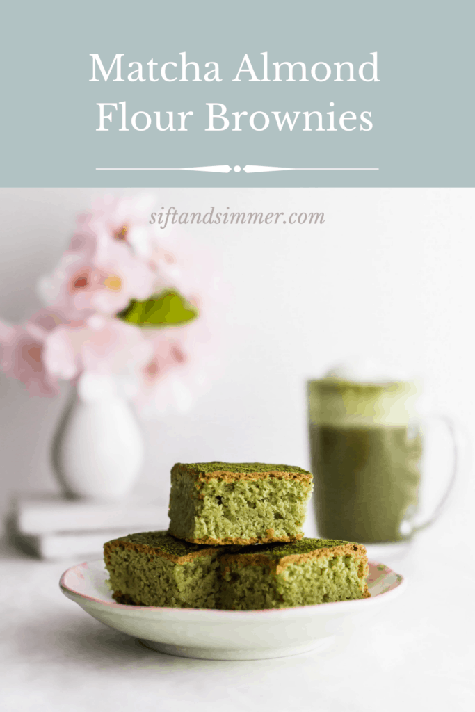 A stack of matcha almond brownies on a small plate, matcha latte in background with text overlay.