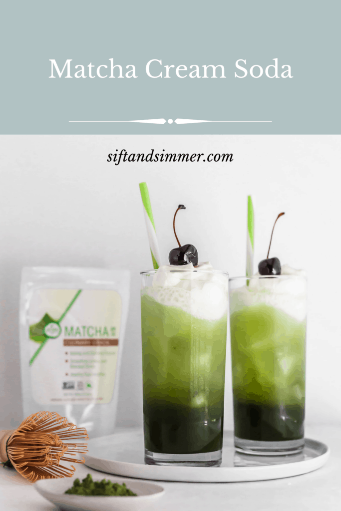 2 layered matcha cream soda in glass with cherry and green and white straws, tea packaging in background with text overlay.