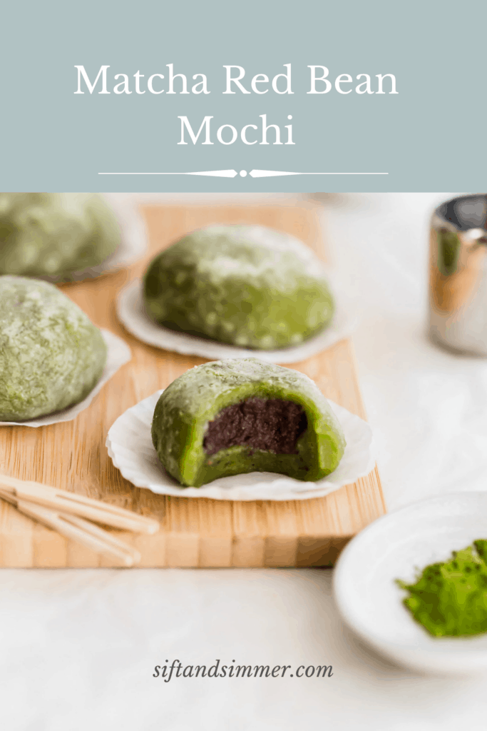Bitten matcha mochi on cupcake liners on wooden board, revealing red bean paste inside, toothpicks and matcha powder in foreground, more mochi in the background with text overlay..