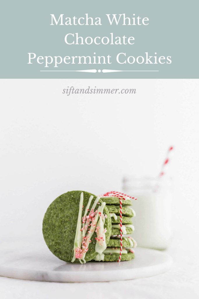 Matcha White Chocolate Peppermint Cookies on marble board with glass of milk with red straw in background, with text overlay.