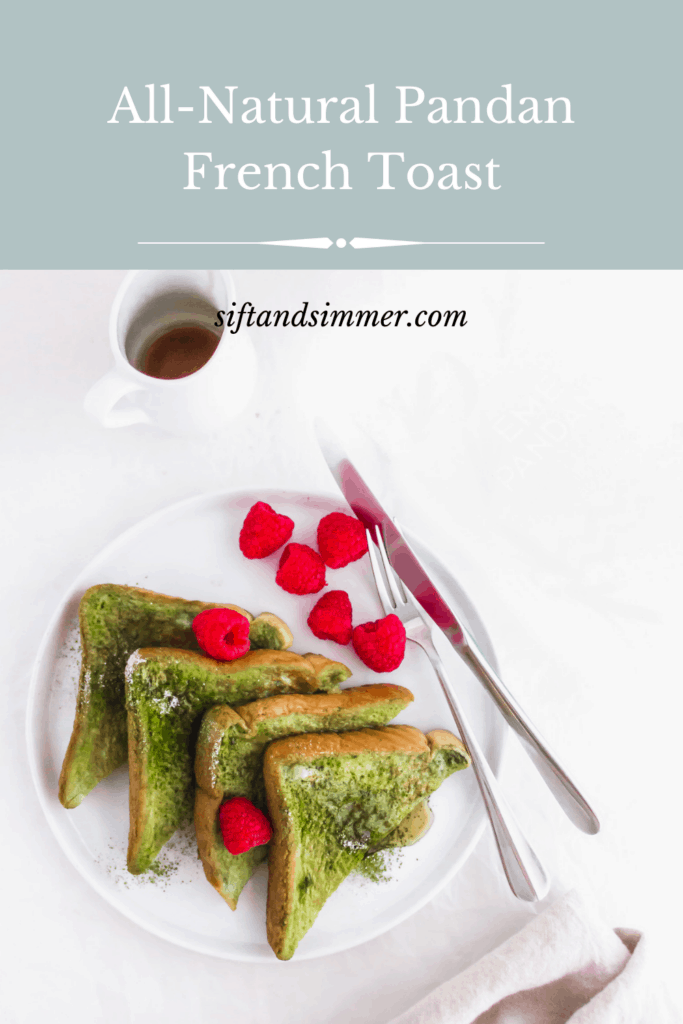Close up of Pandan French Toast on round white plate with raspberries and fork with text overlay.