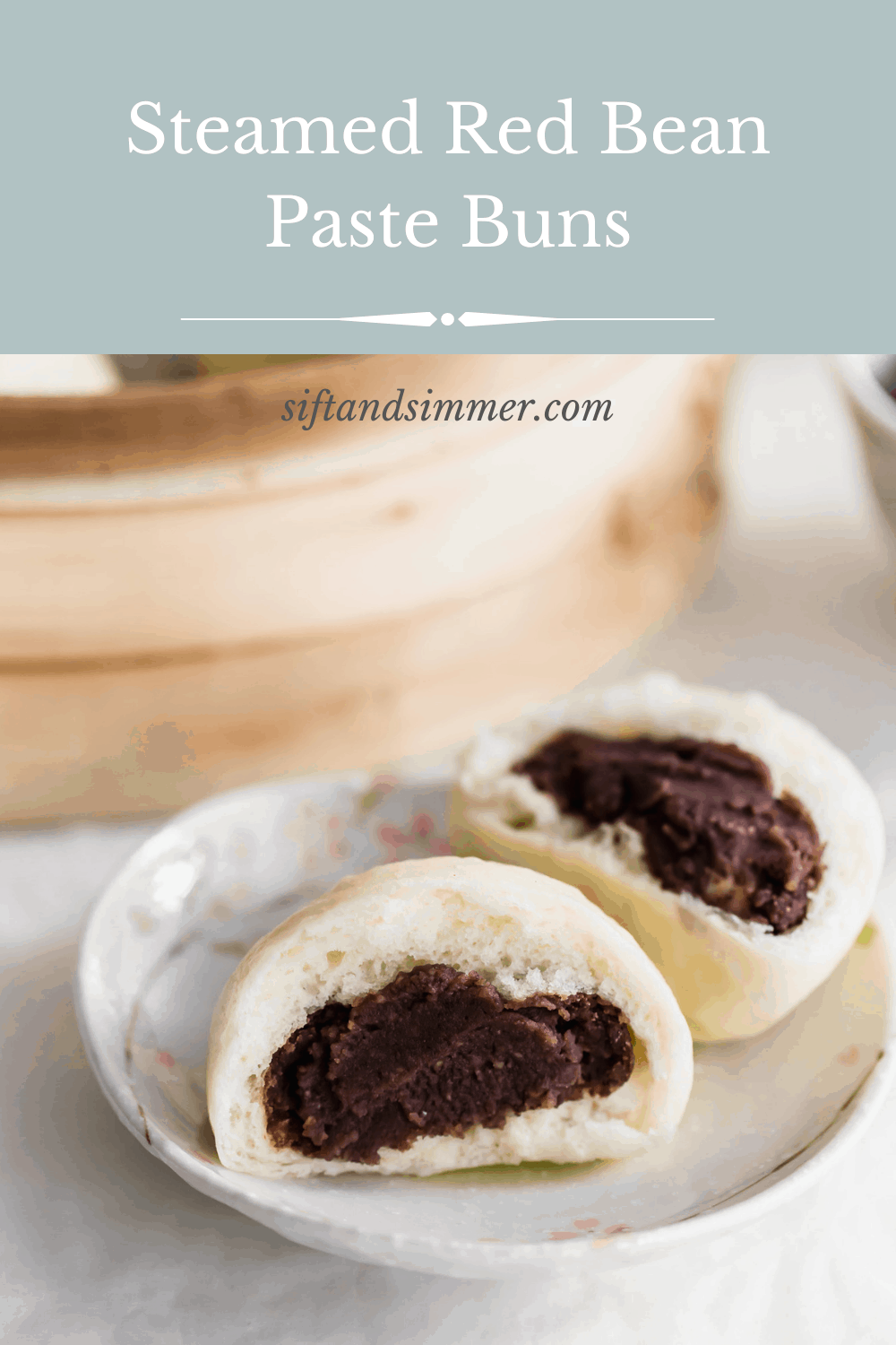 A close up of torn steamed bun revealing red bean paste filling on small plate, with text overlay.