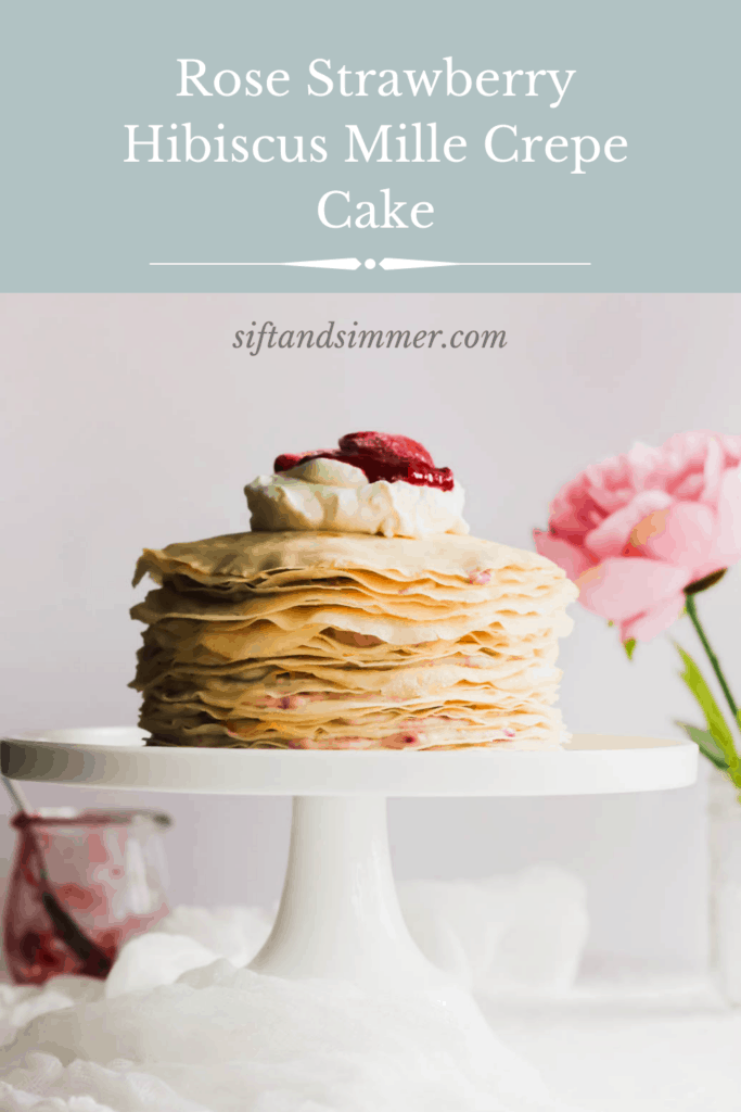Slice of Rose Strawberry Hibiscus Mille Crepe Cake on white cake stand with text overlay.