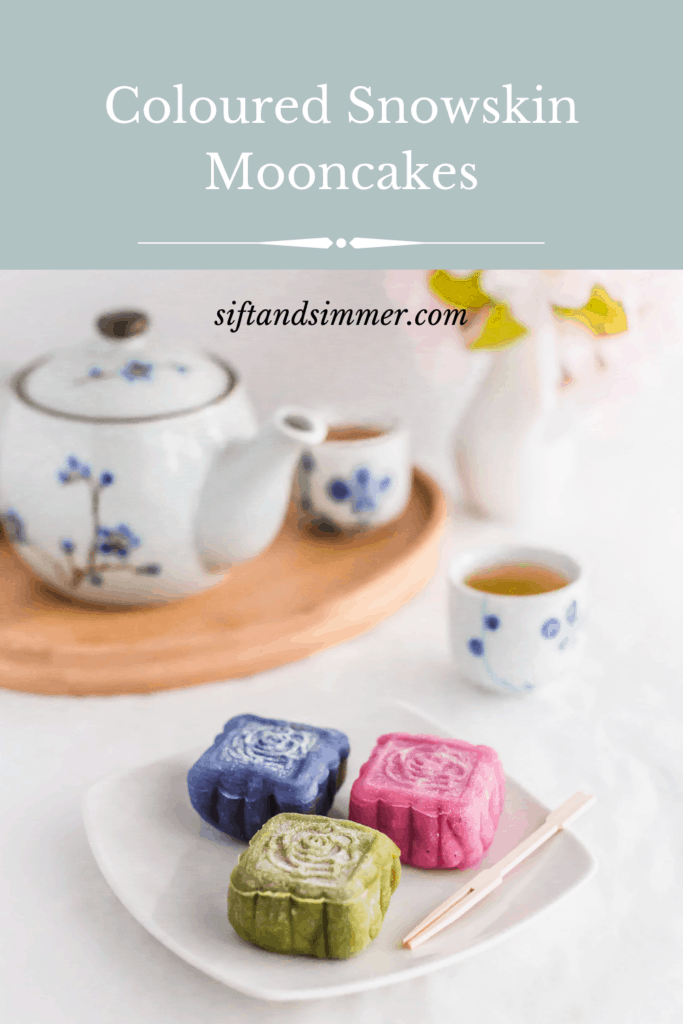 Coloured Snowskin Mooncakes on small white plate, with toothpick with text overlay.