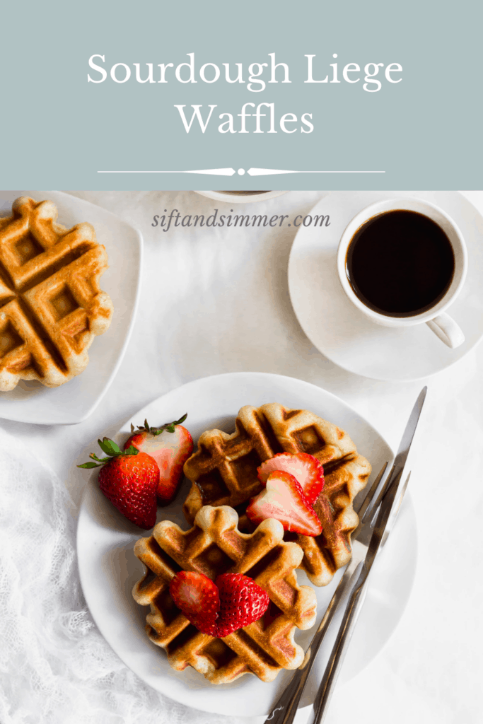 Sourdough liege waffles with strawberries on a white plate with fork and knife, cup of coffee with text overlay.