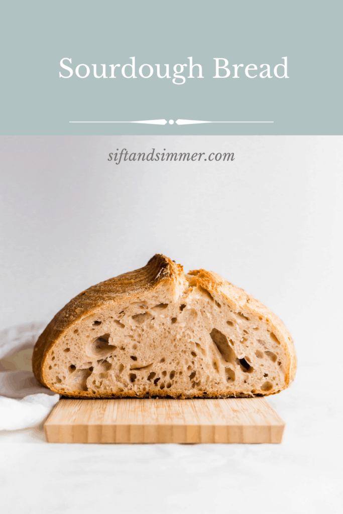 A cut sourdough bread loaf on top of wooden board with text overlay.