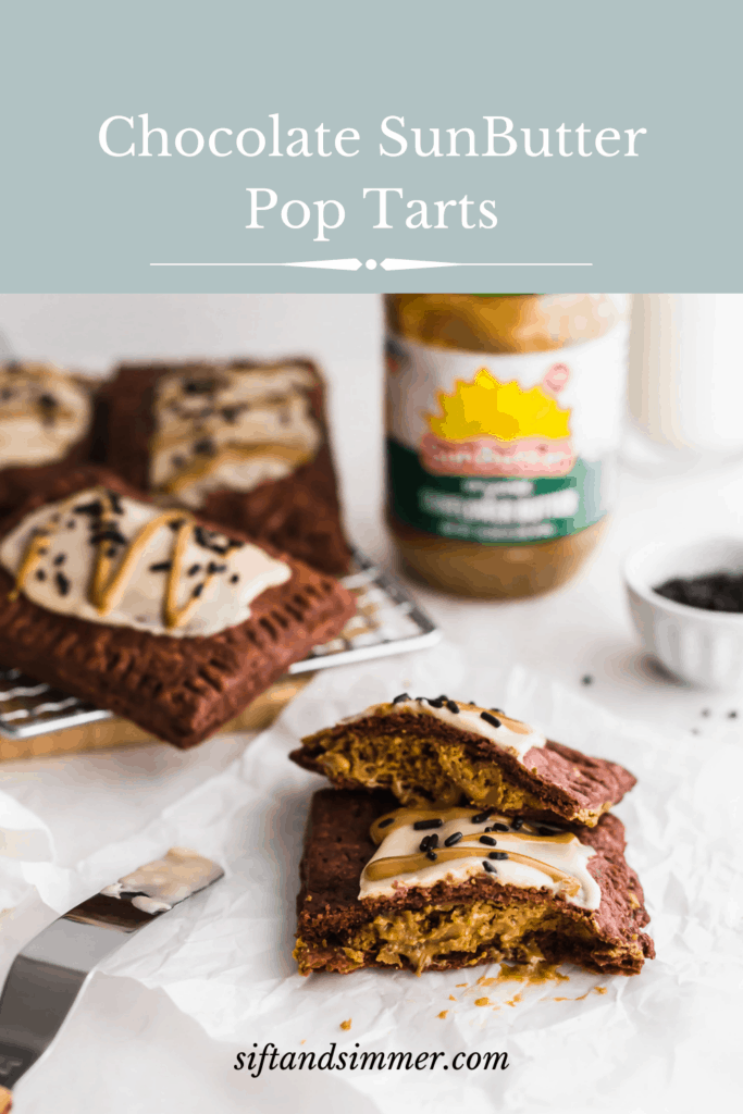 A Sunbutter chocolate pop tart on a piece of white parchment with offset spatula on the side, pop tarts on a cooling rack, SunButter jar, glass of milk in background with text overlay.