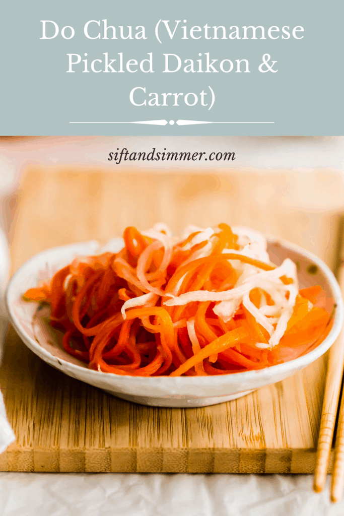 Pickled daikon and carrot on a small plate on wooden board with text overlay.