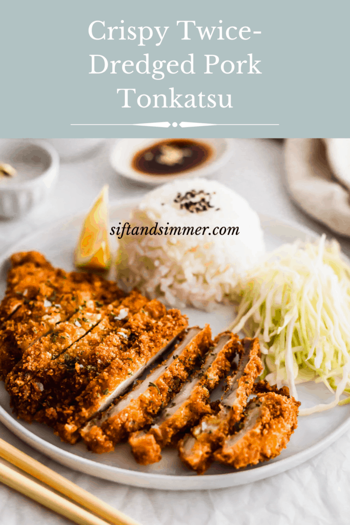 Sliced pork tonkatsu on white plate with rice and shredded green cabbage, with text overlay.