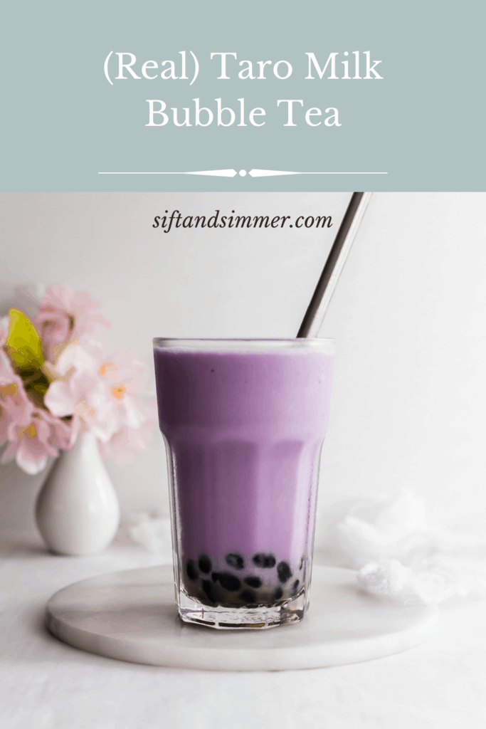 Glass of purple taro milk bubble tea with stainless steel straw on marble trivet, with text overlay.