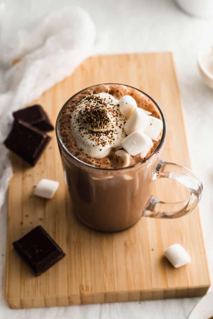 Close up of hojicha hot chocolate in glass mug.