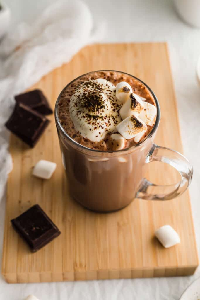 Close up of hojicha hot chocolate with bruleed marshmallows.
