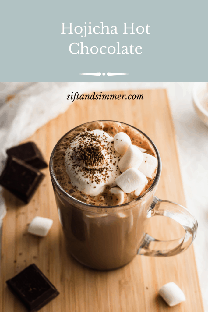 Hojicha hot chocolate with marshmallows on wooden board, with text overlay.