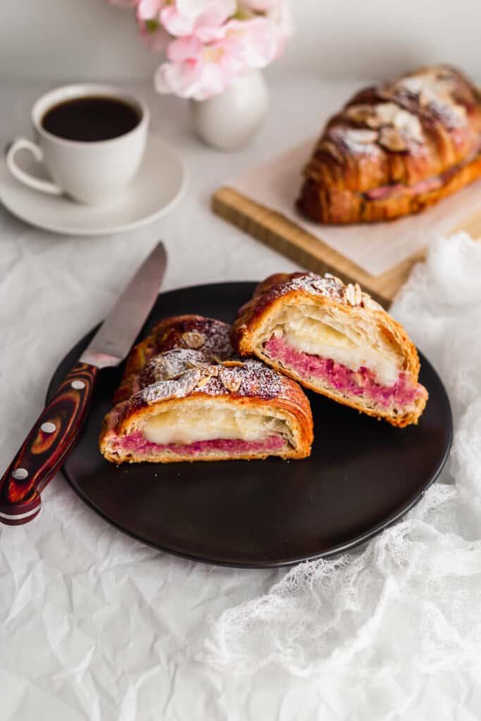 Cut mochi croissants on round black plate.