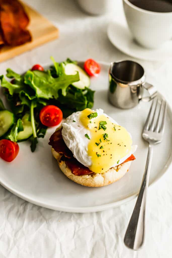 English muffin with bacon and egg on top.