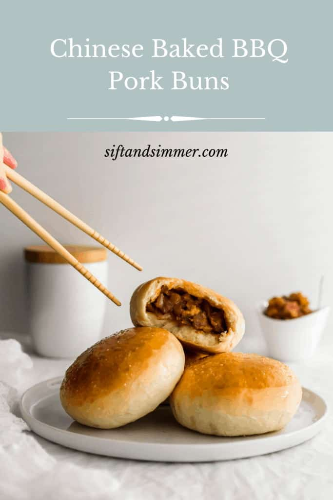Baked BBQ pork buns on a white plate with chopsticks coming in from the left.