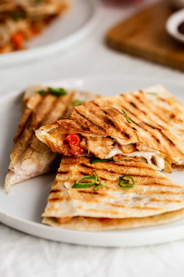 Close up of BBQ turkey quesadillas on white plate.